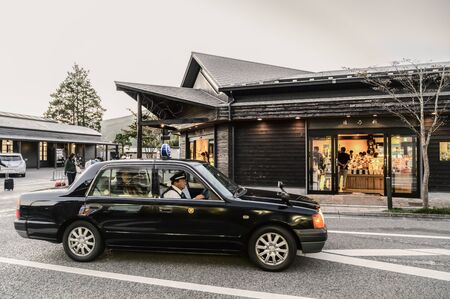 Yufuin, JAPAN - 14 October 2019 : Tourists travel around Yufuin, the touristic landmark on Kyushu Island in South of Japan.