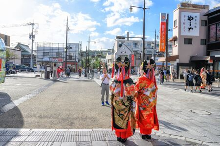 Fukuoka, JAPAN - 15 October 2019 : Japanese girls with kimonos suit (Yukata) to pay respect at Dazaifu Tenmangu Shrine, one of the most well-known Shinto shrines in Japan.