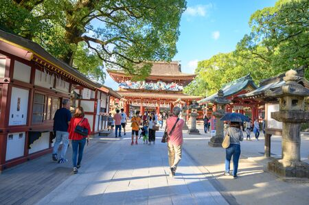 Fukuoka, JAPAN - 15 October 2019 : Tourists coming to pay respect at Dazaifu Tenman-gu Shrine, one of the most well-known Shinto shrines in Japan. Redactioneel