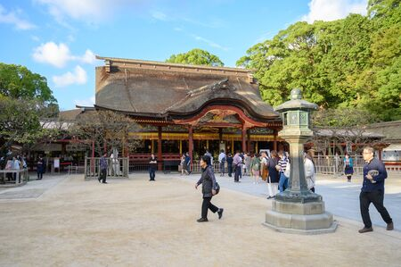 Fukuoka, JAPAN - 15 October 2019 : Tourists coming to pay respect at Dazaifu Tenmangu Shrine, one of the most well-known Shinto shrines in Japan.