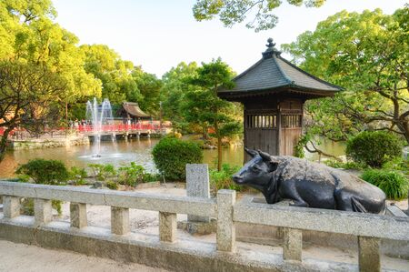 Fukuoka, JAPAN - 15 October 2019 :Brass statue of the legendary ox in Dazaifu Tenmangu shrine, one of the most well-known Shinto shrines in Japan.
