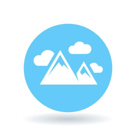blue icon: Mountain range icon. Mountains symbol. Mountain peak sign. White mountains with clouds icon on blue circle background.