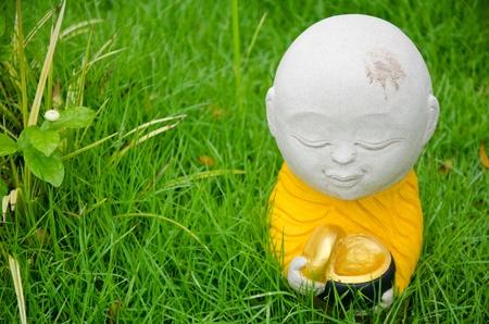 novice monk statue