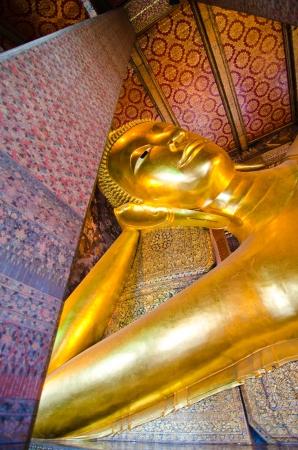 Reclining Buddha statue in Wat Pho Stock Photo