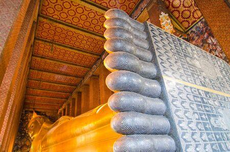 Golden reclining buddha from toe