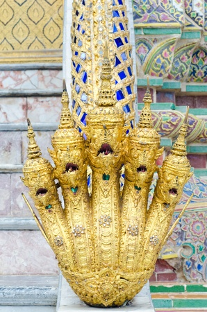 Gold Serpent holy in royal grand palace Thailand  photo