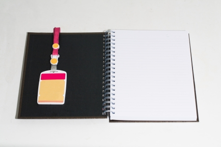 Open full white book with personal card