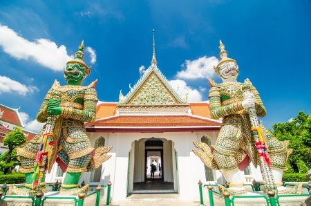 Two statue giant at churches Wat Arun, Bankok Thailand Stock Photo