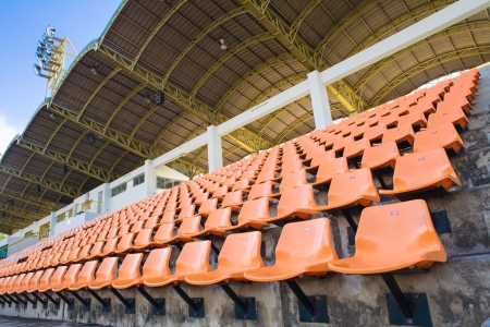 Stadium Orange Chair with roof and blue sky photo