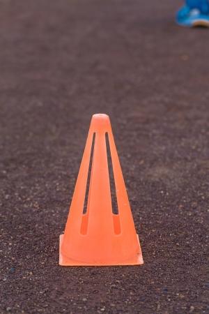 traffic cone - a orange road cone - orange traffic cone placed in road - Rubber cone