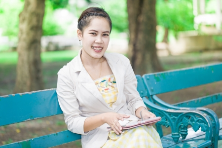 young asian woman with tablet computer outdoor Stock Photo