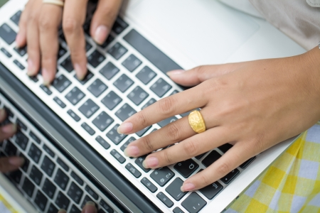Person Typing on a modern laptop on park Stock Photo