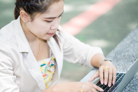 business asian woman working on computer, outdoor Stock Photo