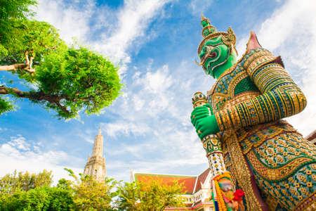 thai giant in the temple with blue sky photo