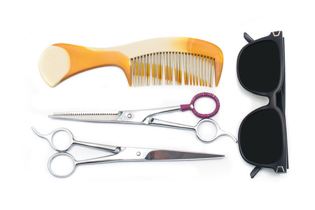 Hair scissors whith comb and eyeglasses photo