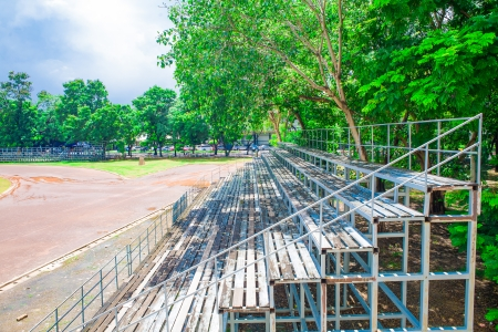 green grandstand under the tree, stadium photo