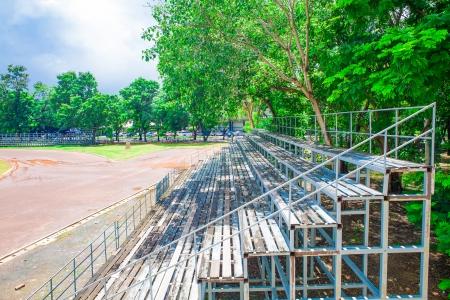 grandstand: green grandstand under the tree, stadium