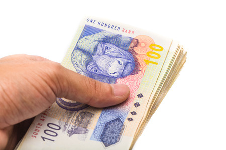south african man holding new bank notes isolate on white background Standard-Bild