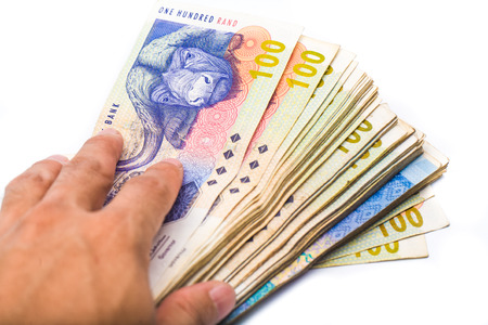rand: south african man holding new bank notes isolate on white background Stock Photo