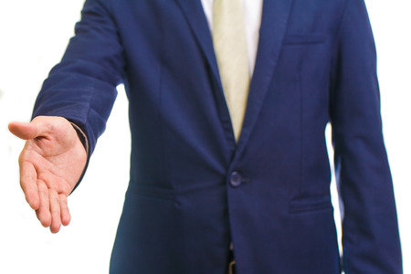 Businessman giving hand for handshake, isolated on white