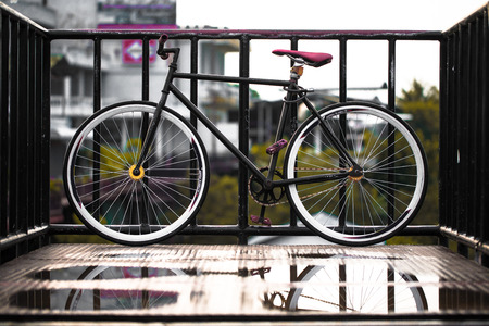 The fix gear bicycle in classic stye, water reflex photo