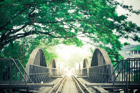 Railway Bridge and Rails with green leaf frame, art photo