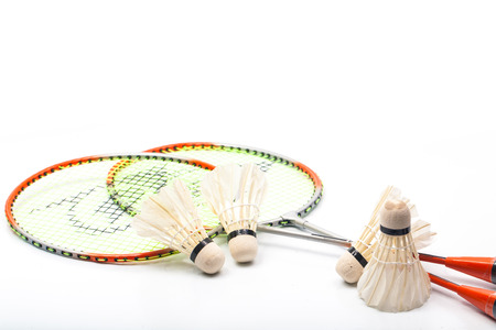 Badminton racket and shuttlecock isolated on white, twin photo
