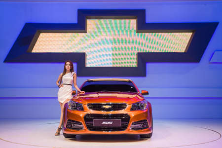 NONTHABURI - DECEMBER 8: Unidentified modellings posted over chevrolet ss display on stage at The 30th Thailand International Motor Expo on December 8, 2013 in Nonthaburi, Thailand. Editorial