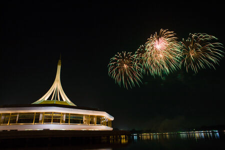 Celebrate firework at Suanluang RAMA IX reflect in water, Thailand