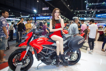 NONTHABURI - DECEMBER 8: Unidentified modellings posted over Ducati motorcycle display on stage at The 30th Thailand International Motor Expo on December 8, 2013 in Nonthaburi, Thailand.