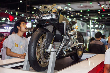 NONTHABURI - DECEMBER 8: Unidentified people look at Ducati 1199 motorcycle display on stage at The 30th Thailand International Motor Expo on December 8, 2013 in Nonthaburi, Thailand.