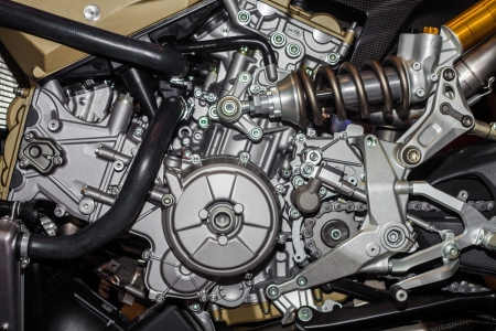 Closeup of chromed motorcycle engine, 4 piston Stock Photo