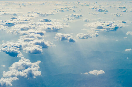 nimbi: clouds in the blue sky with  sun light from above Stock Photo