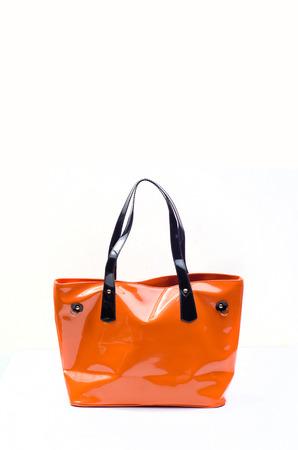 saddlebag: Orange women bag isolated on white background