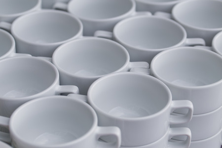 Row of coffee cups with spoon photo