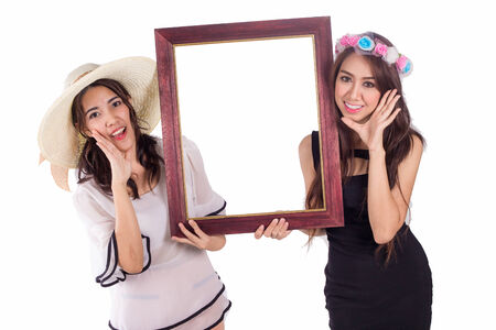 Asian women holding the frame from picture isolated on white background