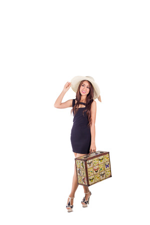 Asian girl goes on vacation with travel bag isolated on white, hand catch hat Stock fotó