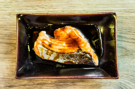 Grilled Salmon steak on wooden table photo