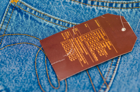 Blank leather jeans label sewed on a blue jeans. label on jeans photo