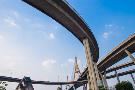 twice: Concrete highway overpass Bhumibol Bridge in Thailand. The bridge crosses the Chao Phraya River twice. Stock Photo