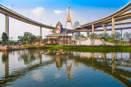 bhumibol: Concrete highway overpass Bhumibol Bridge in Thailand. The bridge crosses the Chao Phraya River twice. Editorial