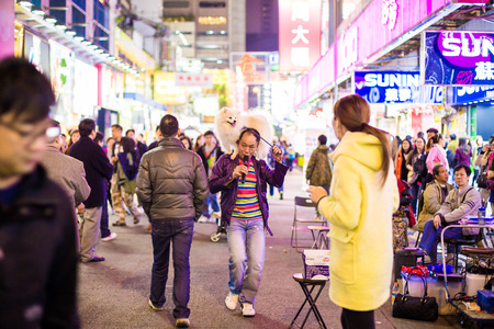 HONG KONG - DEC 6: People show on Mongkok street on December 6, 2014. Mongkok street is a very popular shopping place in Hong Kong.