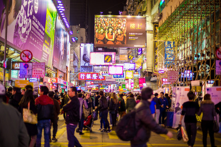 HONG KONG , CHINA - DEC 6 : Mongkok at night on December 6, 2014 in Hong Kong, China. Mongkok in Kowloon is one of the most neon-lighted place in the world and is full of ads of different companies.