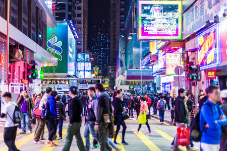 HONG KONG - DEC 6: Mongkok district at night on December 6, 2014 in Hong Kong. Mongkok district is a very popular shopping place in Hong Kong. Editorial