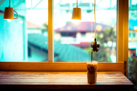 Cup of coffee on table in cafe, Classic coffee shop