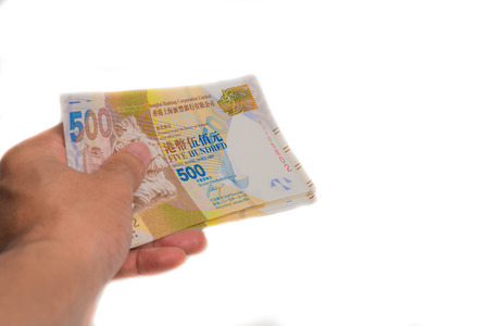 pay for: Banknote hkd in hand pay for goods and service, Hong Kong $500 banknote
