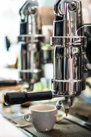 coffeeshop: Coffee machine prepares espresso in coffeeshop, close-up