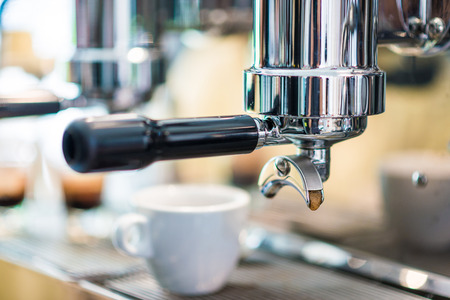 Prepares espresso in modern coffee shop, Coffee machine
