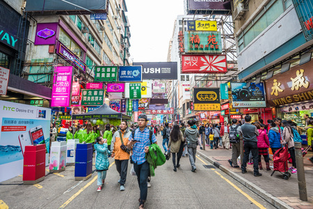 HONG KONG - December 7 : Crown at Mongkok  on December 7, 2014 in Hong Kong, China. Mongkok in Kowloon is one of the most Banner place in the world and is full of ads of different companies. Editöryel