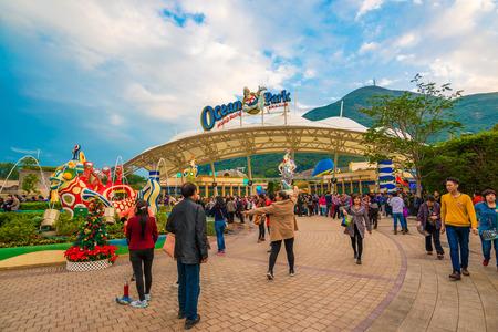 OCEAN PARK, HONGKONG - DECEMBER 9: Tourist Group on December 9, 2014, Ocean Park, Hongkong.  Tourists group on the entertainment park. Ocean Park also a center for giant panda breeding.